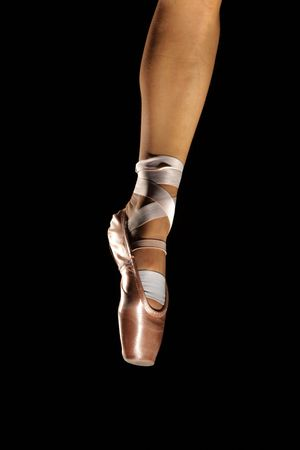 foot with pointes of ballet dancer isolated on black Stock Photo - 6068983