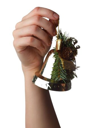 hand holding a Christmas bell photo