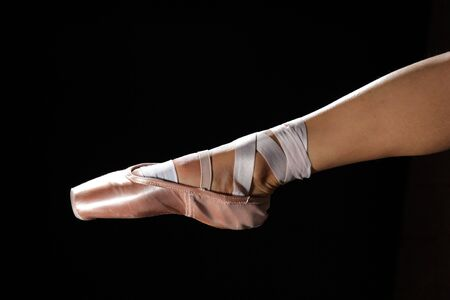 foot with pointes of ballet dancer on black Stock Photo - 6347515