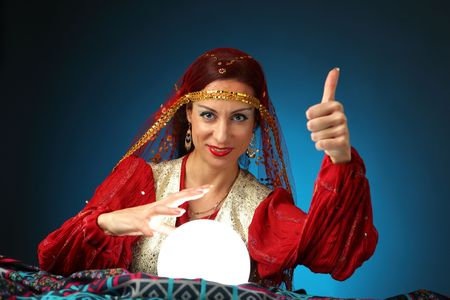 fortuneteller: fortune-teller showing everything will be all right