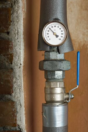 thermometer on the pipe and tap Stock Photo - 6446621