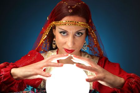 eye ball: fortune-teller with a shining crystal ball