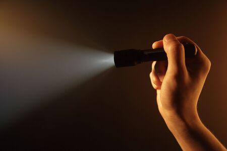 limelight: hand holding pocket flashlight Stock Photo
