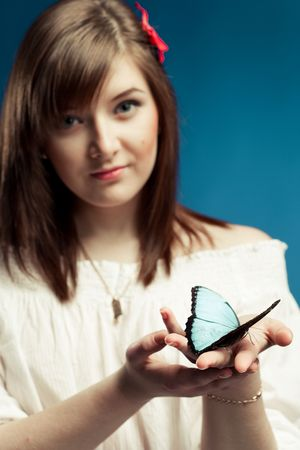 young woman holding a butterfly  photo