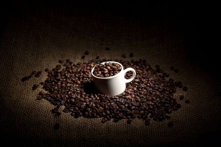 coffee sack: cup full of coffee beans