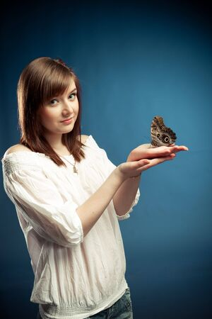 attractive girl holding a butterfly  photo
