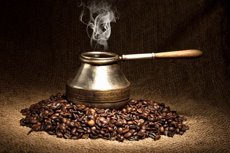 turkish coffee: old coffee pot with smoke