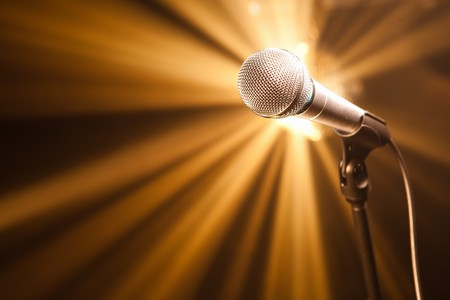 microphone on stage with golden rays photo
