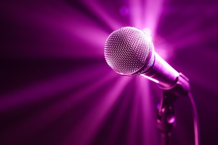 microphone on stage with purple background Stock Photo - 6930191