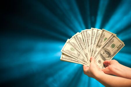 fantail: hand holding a 100 dollars fantail Stock Photo