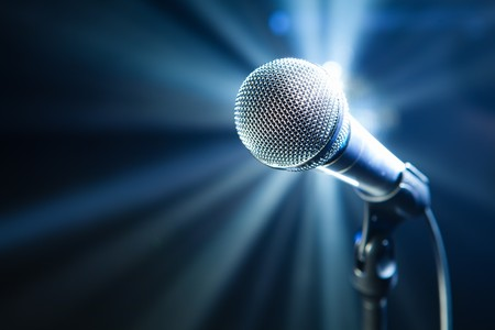 microphone on stage with blue background photo
