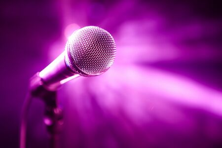 microphone on stage with purple background photo