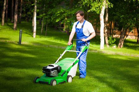lawn mower man on the backyard photo