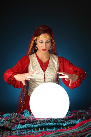 gypsy woman: fortune-teller with a shining crystal ball