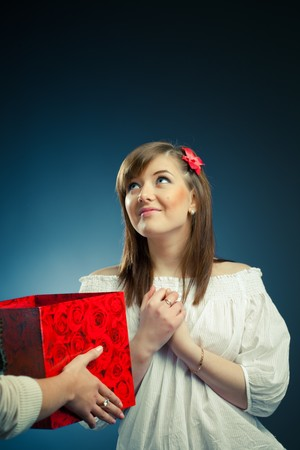 beautiful girl receives opened gift box photo