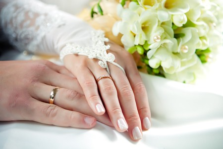 gold rings: hands of newlyweds