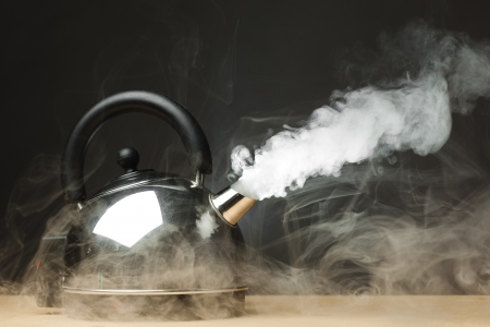 boiling water: boiling kettle with dense steam Stock Photo