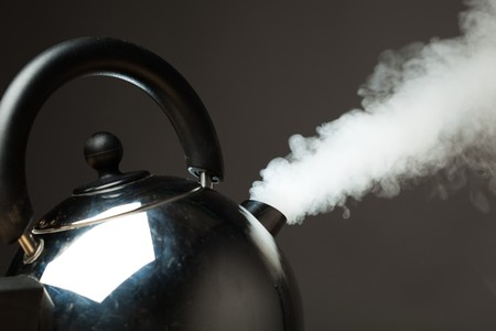 kettles: boiling kettle with dense steam Stock Photo