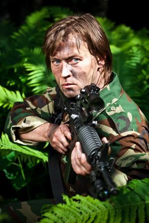 infantryman: soldier aiming a gun