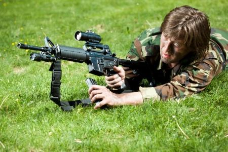 reloading: soldier in the field reloading the gun