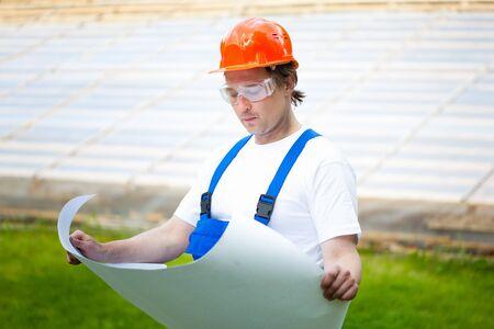 engeneer: engeneer looking at the construction plan