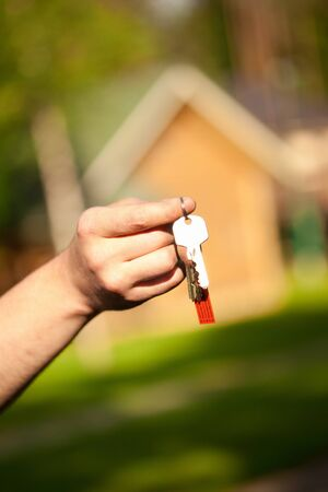 hand holding keys, house in the background Stock Photo - 7352813