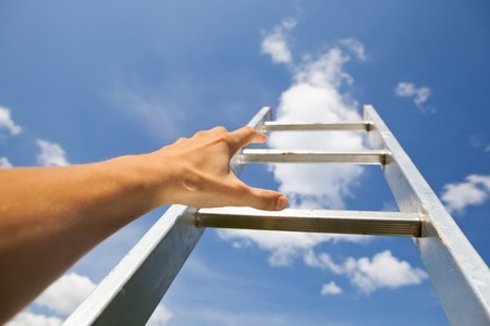 scrambling: man scrambling by stairs to the sky Stock Photo