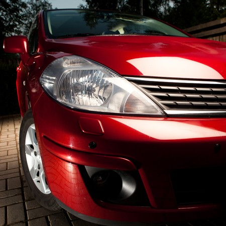 headlights: part of a red car Stock Photo