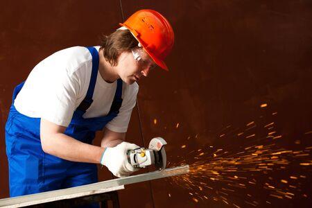 worker cutting metal photo