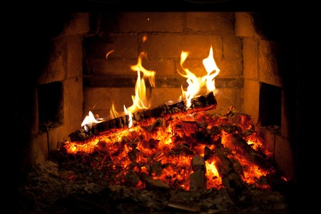 ashes: burning fire in the fireplace