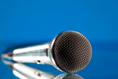 microphone against the blue background Stock Photo - 8119613