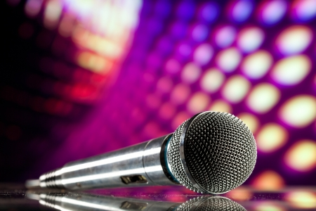 mike: microphone against purple disco background
