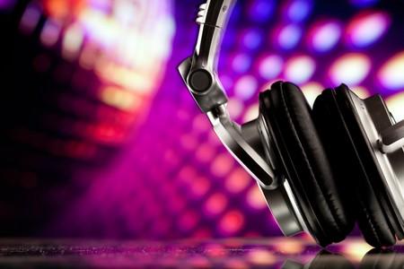 concert lights: headphones against purple disco background