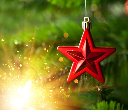 Christmas-tree ornament - red star with glare sparkles photo