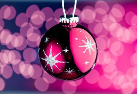 purple Christmas ball with defocused lights photo