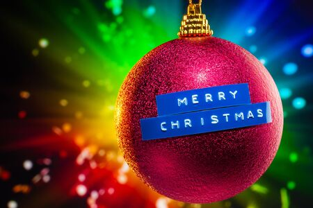 Merry Christmas ball with colorful shiny background photo