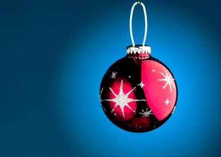 purple Christmas ball on blue photo