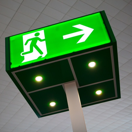 green emergency exit sign photo