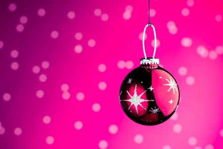 Christmas decoration against purple bokeh background photo