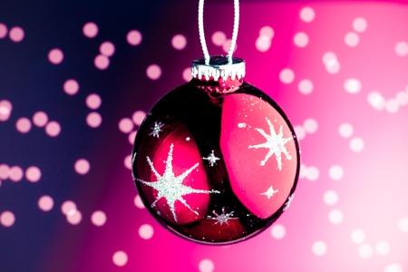 Christmas decoration against purple bokeh background photo