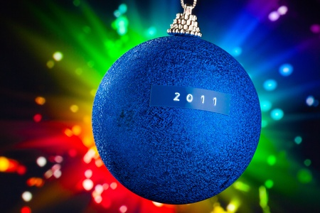 Christmas ball with 2011 title and colorful background photo