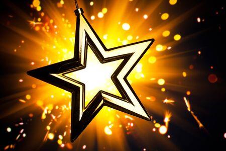 stardom: Gold star against orange fireworks background
