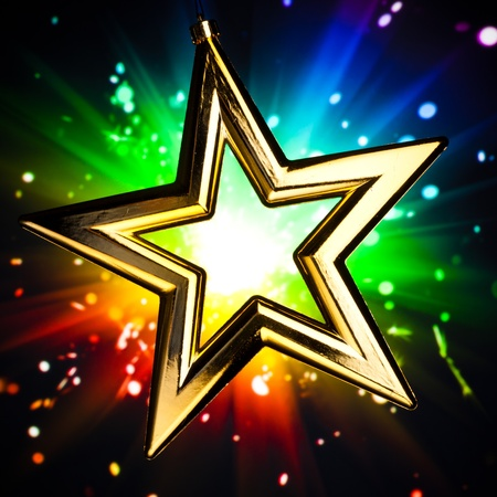 Gold star against multicolor shiny background Stock Photo - 8316965