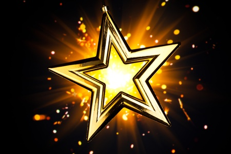 ster: glanzende gouden ster tegen oranje fireworks achtergrond