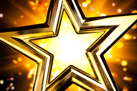 shiny gold star against orange fireworks background Stock Photo - 8316998