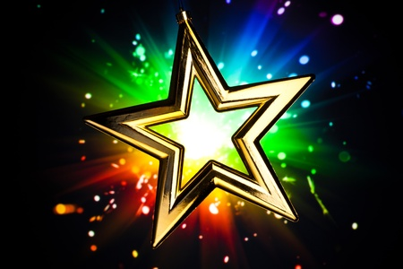 Gold star against multicolor shiny background Stock Photo - 8385256