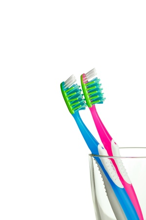 two toothbrushes in the glass isolated photo