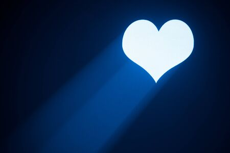 valentine heart projected with blue ray Stock Photo - 8689553