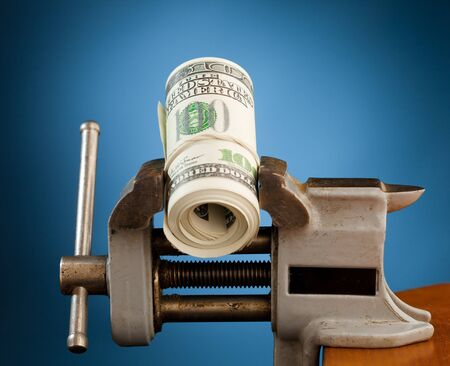 low budget concept - money in the vice tool Stock Photo - 8835637