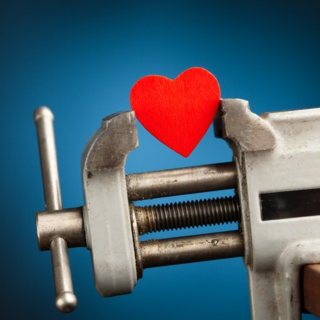 red heart in the vice tool Stock Photo - 8835619